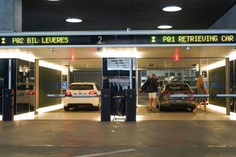 A couple accepts their car in an automated car park.