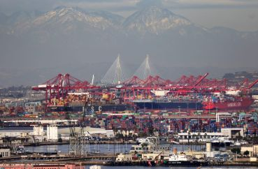 Container ships and at the Port of Los Angeles with the Port of Long Beach in the distance in February 2021. A record number of container ships are on standby to offload cargo to the ports amid a wave of online consumer purchases in the U.S. amid the pandemic.