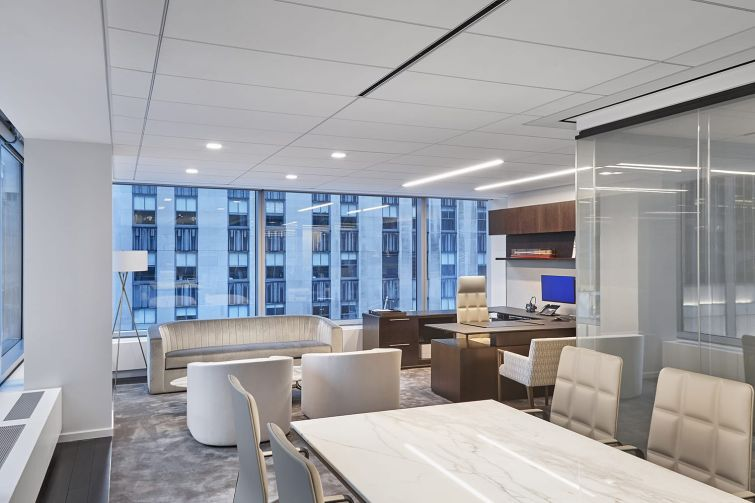 A conference room that features more casual midcentury-style seating.