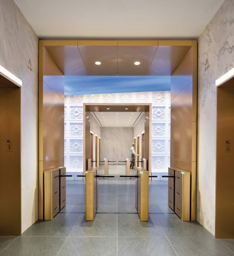 The updates, which include new brass entry portals and marble walls in the elevator lobby.