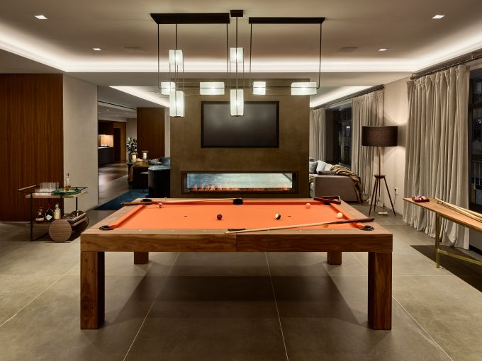 The game room with a pool table just beyond the wall.