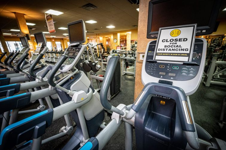 Signs are posted for social distancing on machines throughout the facility. Gyms are still currently closed for indoor operations in Southern California.