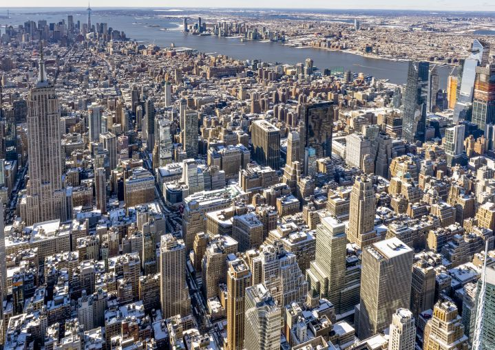Aerial shot of a large city with many buildings.