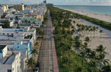 An aerial view of a desolate Ocean Drive in Miami Beach on March 24, 2020 after hotels were closed at the start of the COVID-19 pandemic. Lodging real estate investment trusts trimmed their losses in the fourth quarter to less than half of what they incurred in the second quarter when government shutdowns were in effect.