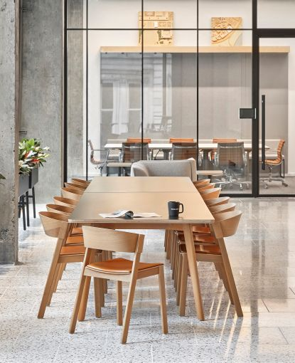 The pantry has a long table that includes outlets for working or hosting clients.