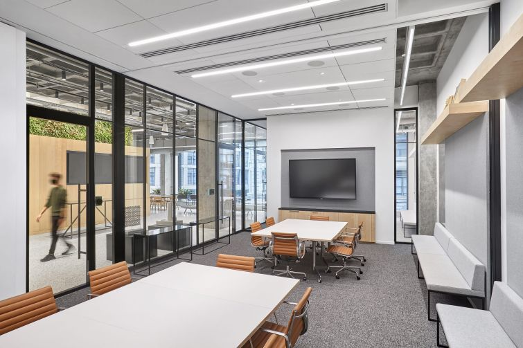 The large conference room has glassed-in walls and a retractable wall that can divide the room in half.