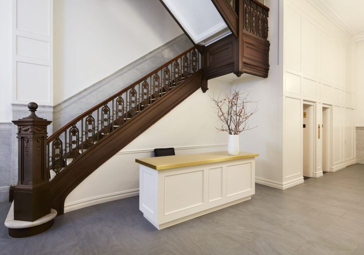 The marble and bronze staircase was sanded and restored to its original color.