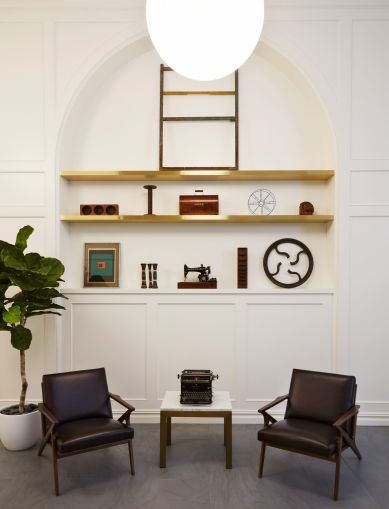 Outpost Architecture decorated the shelves with historic sewing machines and other historic garment-making items in a nod to the building's history as a garment factory.