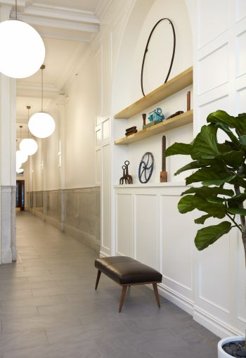 Kaufman reclaimed some retail space from next door to create the alcove shelves and seating.