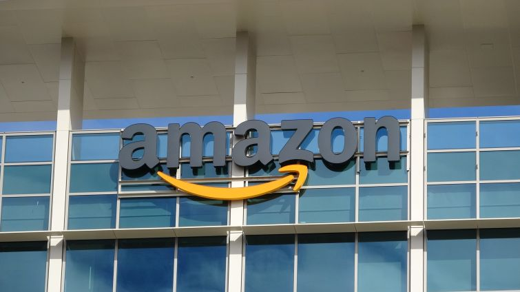 A sign outside a building that says Amazon.