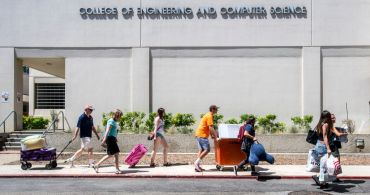 California State University Fullerton students along with the help of their parents and families move their belongings from their vehicles into the residence halls, in Fullerton.