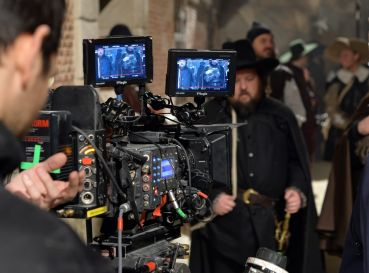 A camera films actor pose on set. After 2020, market experts said studio users would step further into the industrial market to convert into their own space in traditionally secondary markets.