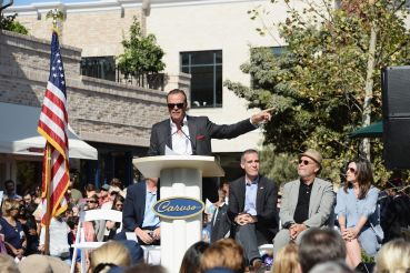 Developer Rick Caruso, Los Angeles Mayor Eric Garcetti, comedian Billy Crystal and producer Janice Crystal attend the Palisades Village grand opening ribbon-cutting ceremony at Palisades Village in 2018.
