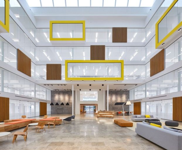 Open plan meeting space and seating area in interior atrium. The Charter Building, Uxbridge, United Kingdom.