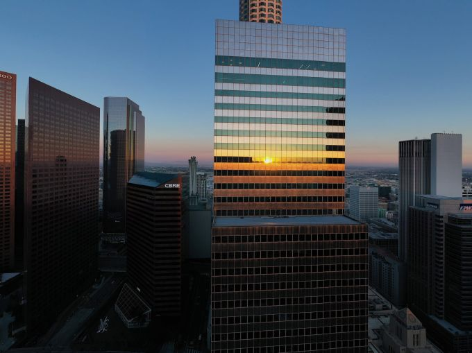 An aerial view shows the tower at 444 South Flower in the downtown Financial District