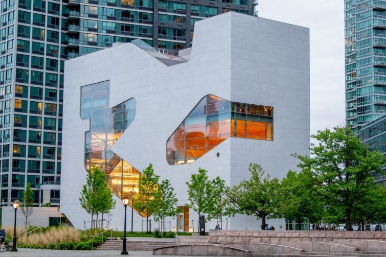 The new $41 million Steven Holl-designed library in the Hunters Point section of Long Island City is emblematic of the construction cost overruns and delays associated with the city's Department of Design and Construction.