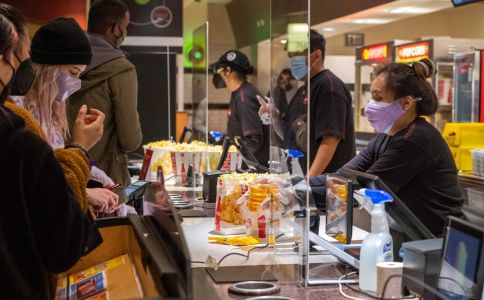 Moviegoers buy pop-corn and drinks at the AMC Burbank theatre concession stand on March 15.