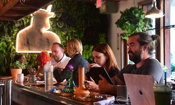 Some in the cannabis industry think legal marijuana dispensaries and consumption sites—like the weed-friendly West Hollywood restaurant Original Cannabis Cafe pictured above—could rescue NYC's struggling brick-and-mortar retail. Others, looking at the hurdles involved in opening cannabis businesses in other states, are much less optimistic.