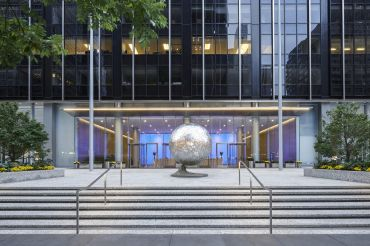 Fisher Brothers' $120 million renovation of 1345 Avenue of the Americas includes an updated plaza with added seating, plantings and a new sculpture.
