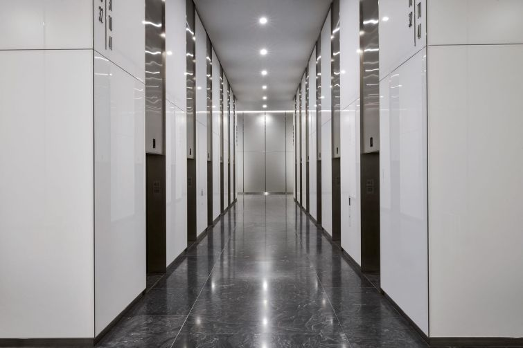 In addition to a renovation of the elevator lobby, the elevator systems were upgraded during the pandemic to destination dispatch.