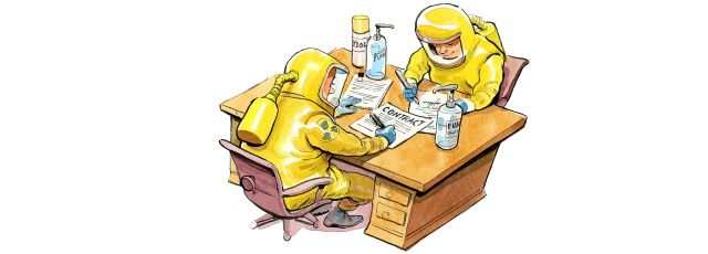 Two men at desk in hazmat suits