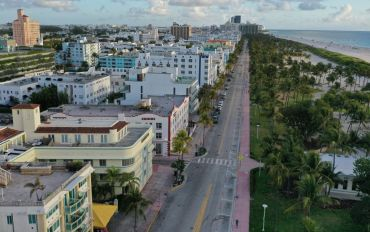 In this aerial view from a drone, desolate Ocean Drive is seen after most visitors have checked out of their hotels on March 24, 2020 in Miami Beach, Florida.