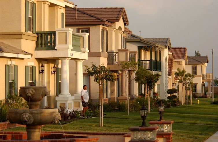 New houses line the street in in Ontario, Calif., located in the Inland Empire, the area east of Los Angeles, in Riverside and San Bernardino Counties.