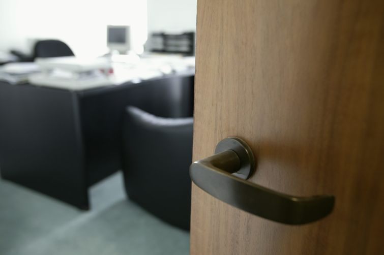 A doorknob opening into an office.