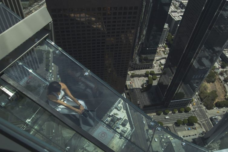 A woman slides down the Skyslide, 70 floors up on the outside of the U.S. Bank Tower in June, 2016