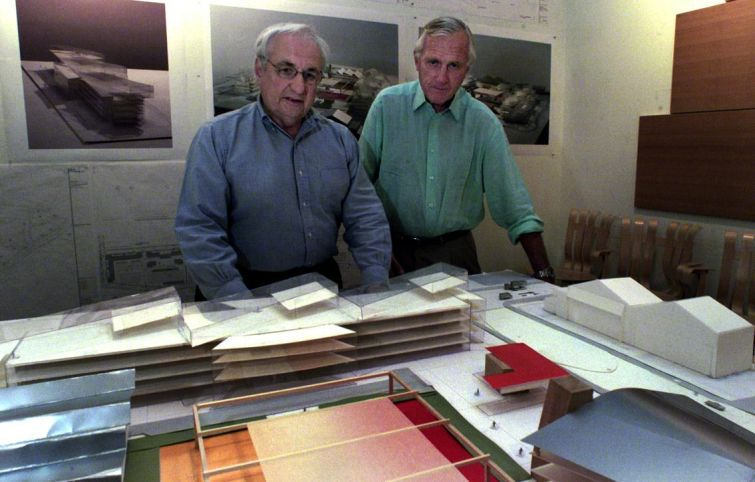 Architect Frank Gehry, left, and Los Angeles developer Robert Maguire stand behind a model of the campus at the giant Playa Vista project at Gehry Partners.
