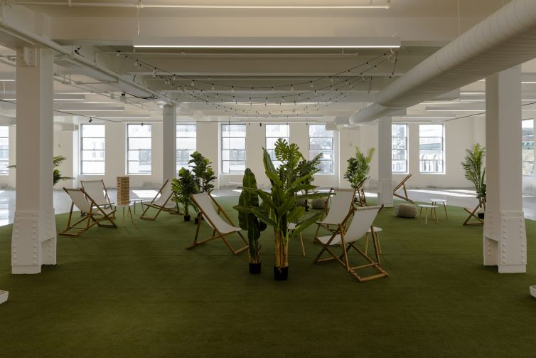 The marketing floor of 295 Fifth includes lawn games, chairs and a swing set.