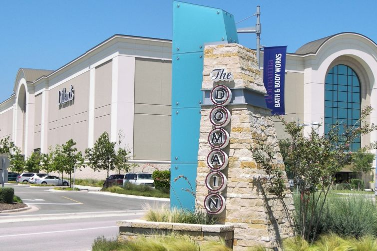 An image of one section of Simon Property Group's The Domain, with Dillard's in the background.