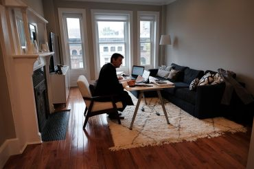 New York City Criminal Court Judge Paul McDonnell works remotely from his Brooklyn apartment due to the coronavirus outbreak. Judge McDonnell, who usually presides over cases in a Manhattan court room, has had to alter his work routine by hearing cases remotely due to the virus outbreak.