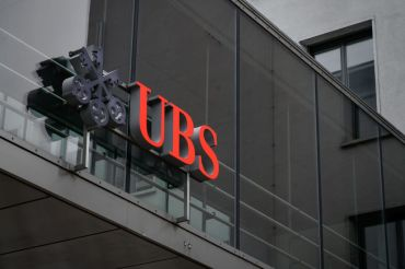 This photograph taken on March 3, 2021 in Zurich shows a sign of Swiss banking giant UBS on their headquarters.