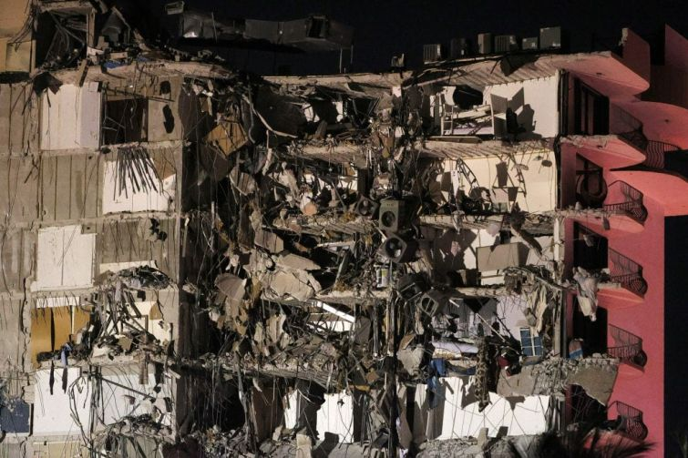 SURFSIDE, FLORIDA - JUNE 24:  A portion of the 12-story condo tower crumbled to the ground during a partial collapse of the building on June 24, 2021 in Surfside, Florida. It is unknown at this time how many people were injured as search-and-rescue effort continues with rescue crews from across Miami-Dade and Broward counties.