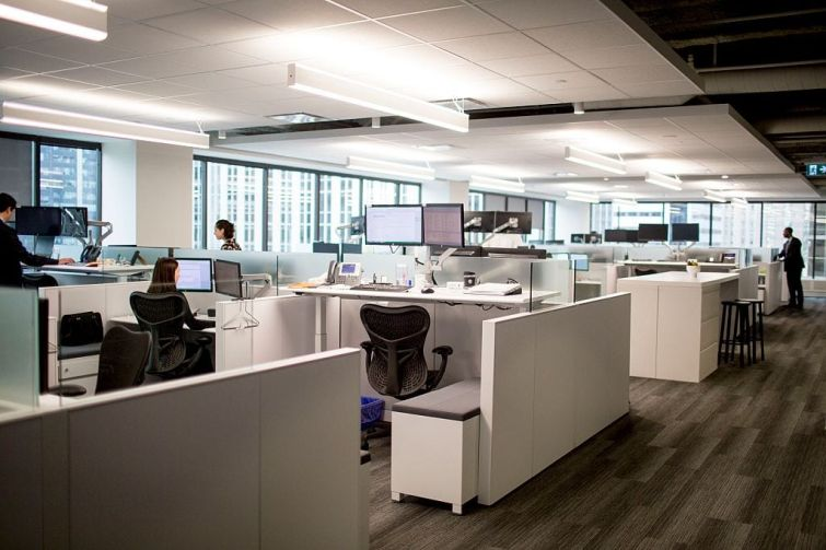 Sit/stand workstations in an office.