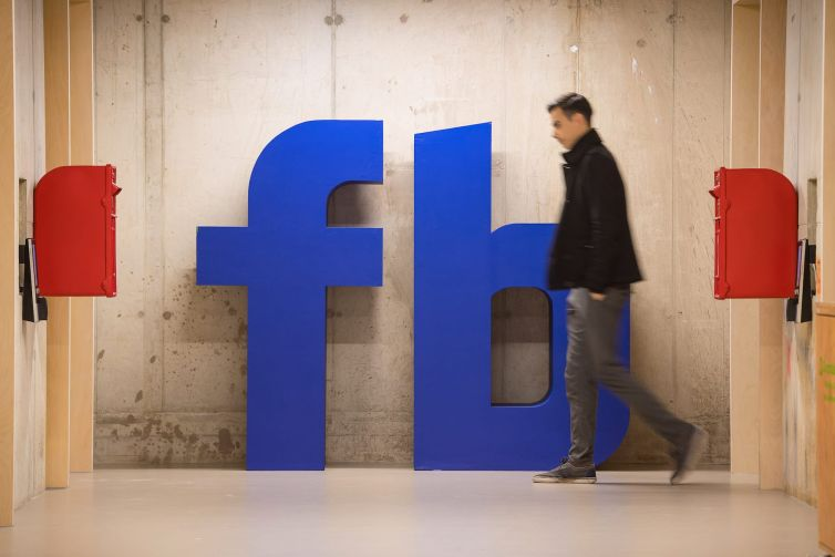 The Facebook logo at Facebook's Frank Gehry-designed headquarters in London.
