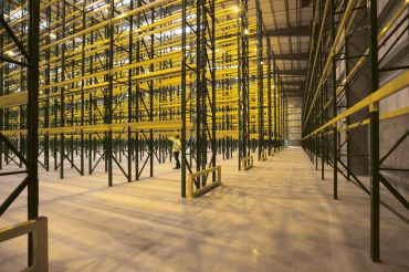 Empty warehouse with shelving and racks. The project, called Knox Logistics VII, is situated on 73 acres at 19115 Harvill Avenue in the city of Perris in Riverside County.
