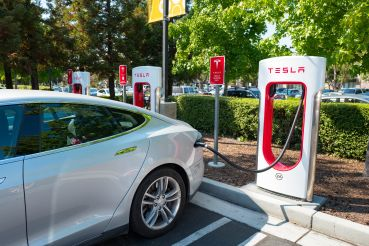 A Tesla automobile plugged in and charging in Mountain View, Calif.