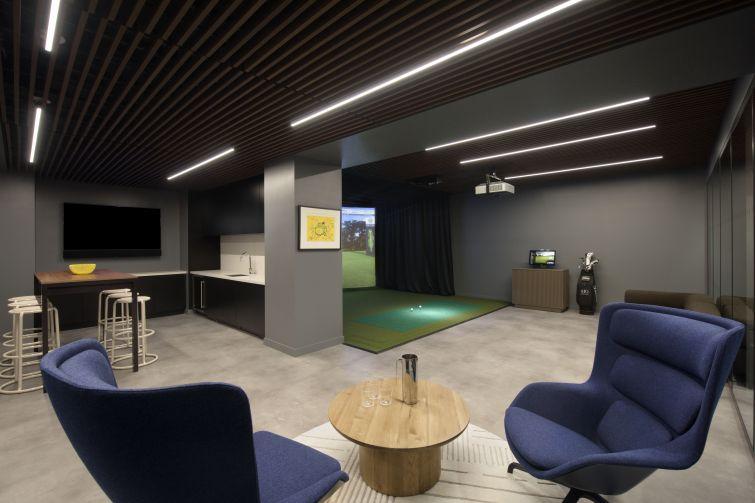The new basement golf simulator and lounge.