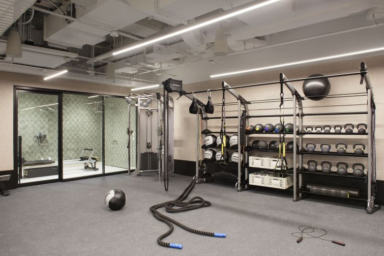 The new gym includes lockers, showers and a few small workout rooms.