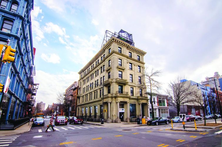 A limestone former bank building at 134 Broadway, near the Williamsburg Bridge, becomes boutique offices with a high-end restaurant on the ground floor and rooftop.