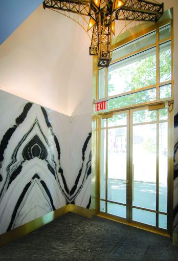 The remainder of the lobby is clad in black and white panda marble and brass.