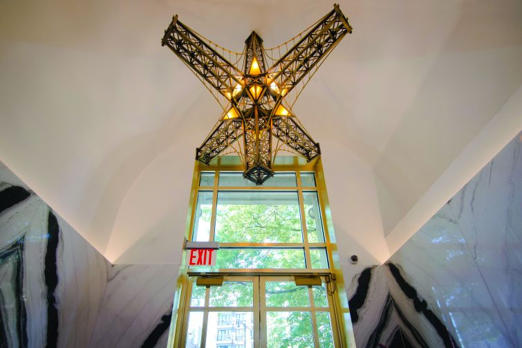Nilson also created this chandelier for the lobby in the shape of pieces of the Williamsburg Bridge.