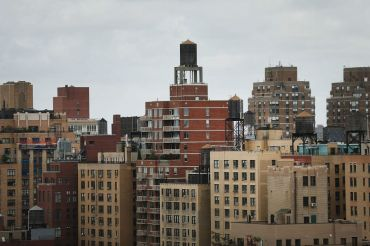 Even as New York City renters sign record numbers of leases, median rents remain down in Brooklyn and Queens.