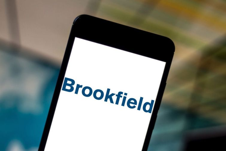 In this photo illustration the Brookfield Asset Management logo is seen displayed on a smartphone.