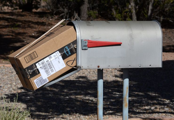 An Amazon Prime package delivered to a mailbox.