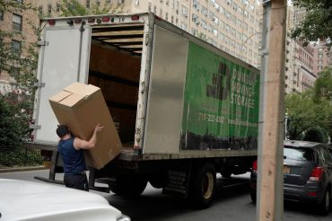 A mover unloads a truck on August 31, 2020 in New York City.