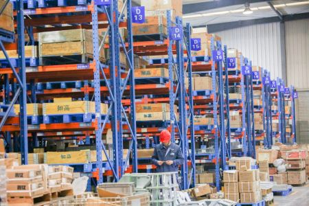 Employees work at a warehouse. Demand for quality industrial space has never been higher.