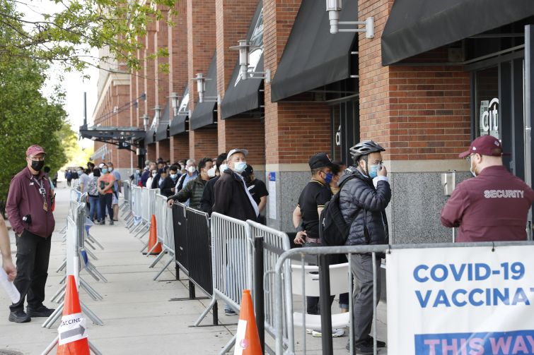 People waiting in line to get into a building.